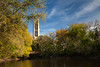 Moser Tower rises above the fall color along the banks of the DuPage River. Naperville, IL<br /> <br /> IL-111016-0086