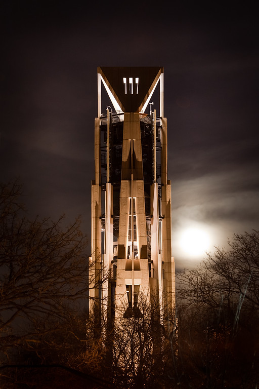 The moon rises behind Moser Tower on an couldy night. Naperville, IL<br /> <br /> IL-090411-0001
