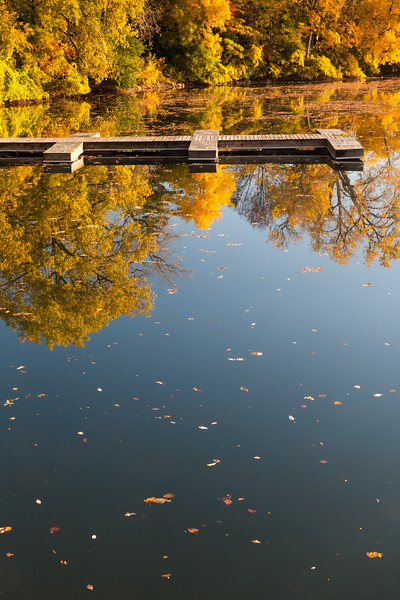 The paddle boat pier on Quarry Lake sits empty on an early fall morning. Naperville, IL<br /> <br /> IL-111009-0065