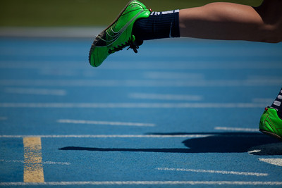 A runner takes off from the blocks during the Class 1A Girls IHSA State Track and Field competition at the O'Brien Stadium on the campus of Eastern Illinois University in Charleston, Illinois on May 17, 2012. (Jay Grabiec)