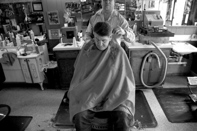 Minor James Miller Junior gets a hair cut at a Red's barber shop on Broadway Avenue in Mattoon, Illinois after receiving his Social Security check in the mail and before getting on a bus to Missouri on March 3, 2009. After getting his monhly check Miller likes to spend some money on him self for things like hair cuts, new clothes or a lunch at a restaurant.   (Jay Grabiec)
