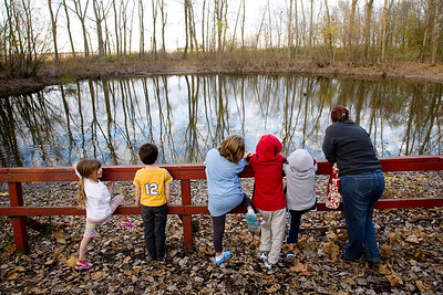 Kegan Kirts, 7, Loda, Emma Tolppanen, 4, Charleston, Benjamin Tolppanen, 6, Charleston, Madilyn Maugeri, Mattoon, Sawyer Kirts, 5, Loda, and Education Director Jennifer Tariq take a moment to look at the pond during a hike as part of the 'Feeling Squirrelly' program at Douglas-Hart Nature Center in Mattoon, Illinois on Monday, November 2, 2009.  (Jay Grabiec)