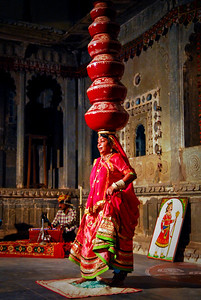 6 pots.  Why not dance on broken glass for good measure? The Matka Bhavai dance.  Matka Bhavai is a popular dance of Rajasthan in which the performer dances with numerous pots balanced on his head. At the same time, he also performs footwork on pieces of glass, nails and swords.