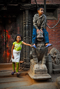 Two kids posing in front of some temple