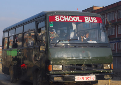 We were first very confused as to why a guy in a military outfit was driving the children's school bus.  Turns out, there's a school nearby for children of people in the Army.