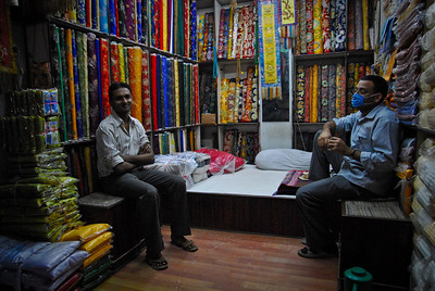 At nights, the storeowners unfold the bed and sleep in the store