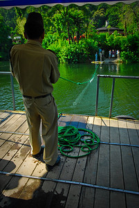 The 'ferry' across the water.  Instead of tying the rope higher so it doesn't get weighed down by water, its immersed in it