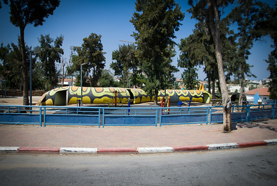 Sderot --- The closest Israeli city to Gaza.  25k rockets have hit Sderot since 2001.  http://www.youtube.com/watch?v=ygb6VrW8WZw --- This is a playground caterpillar/bomb shelter
