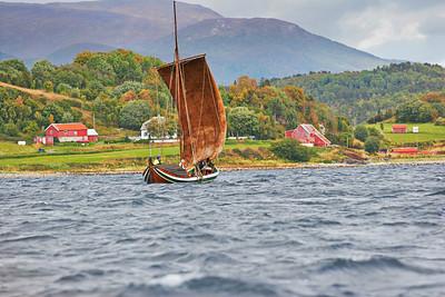 Nordland boat sailing on Ofotfjorden past a village