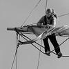 Woman loosening sails - monochrome