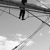 Mariner working high in the rigging - monochrome