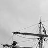 Woman loosening sails
