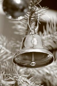 Bell hanging in a fir tree