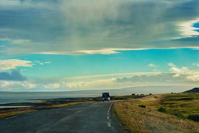 Camper van driving on a road in arctic Norway