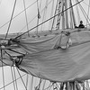 Mariner working in the rigging of a brig - monochrome