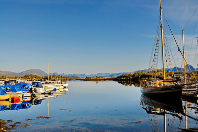 Small boat harbor in Ringstad in northern Norway on a summer evening