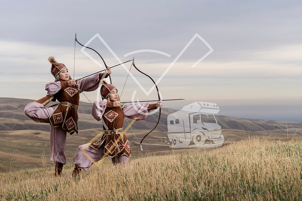 Archer women from Kyrgyzstan dressed up in traditional outfit, Kyrgyzstan