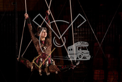Kyrgyz woman dressed up in traditional outfit performing aerial straps skills in the Bishkek State Circus building in Bishkek, Kyrgyzstan