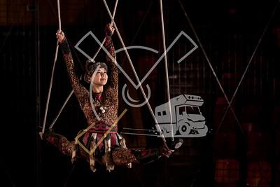 Kyrgyz woman dressed up in traditional outfit performing aerial straps skills in the Bishkek State Circus building in Bishkek, Kyrgyzstan