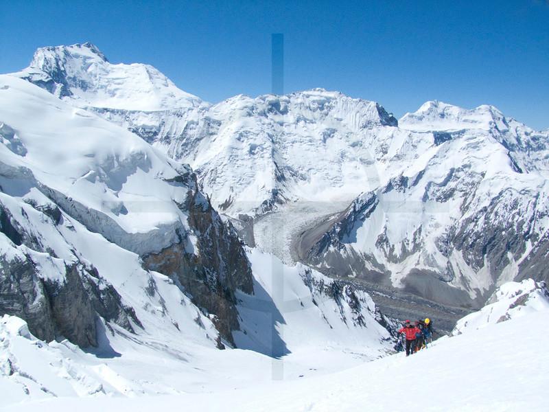 Climbers arriving at Camp I, Southern Crest Route, PIk Korzhenevskaya & view of Pik Somoni, Pamir, Tajikistan