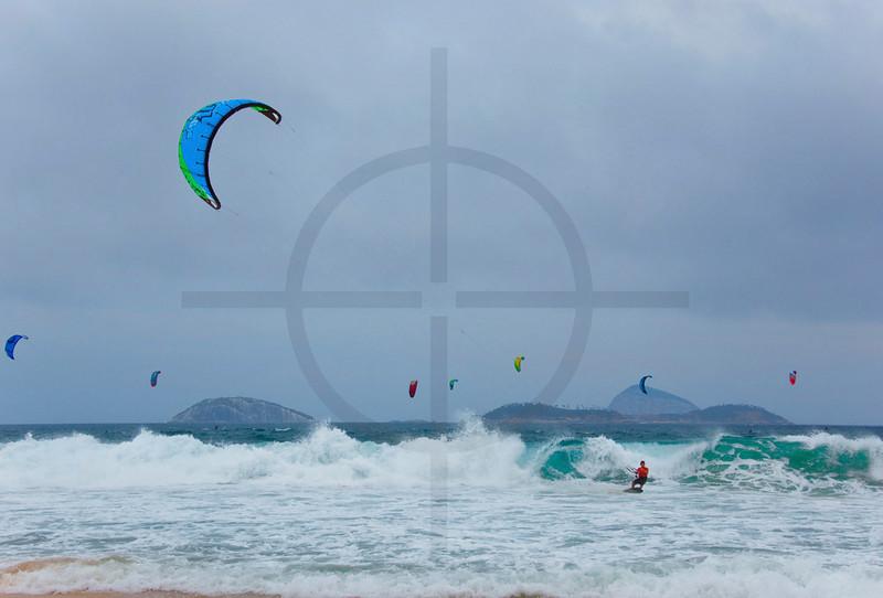 Kite surfers at Ipanema Beach during storm, Rio de Janeiro, Brazil