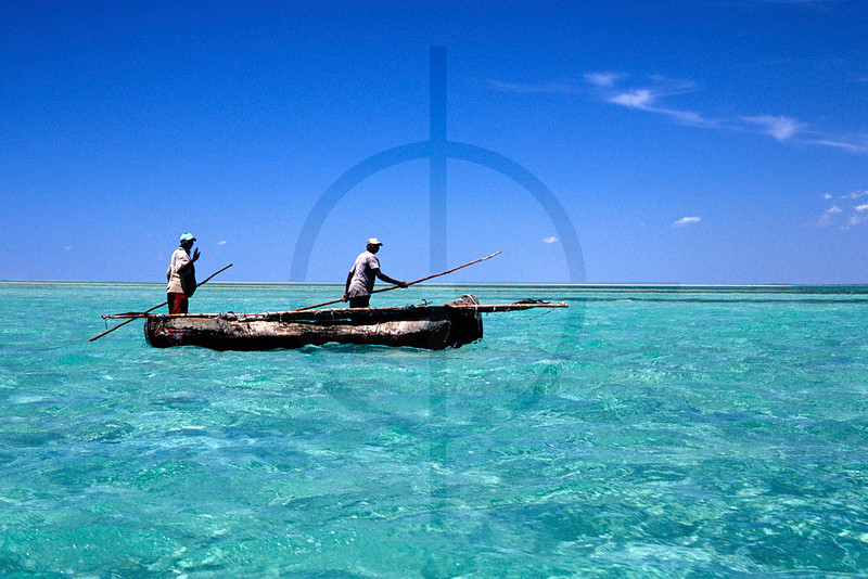 Poling fishermen at low tide, Magaruque Island, Bazaruto Archipelago, Mozambique