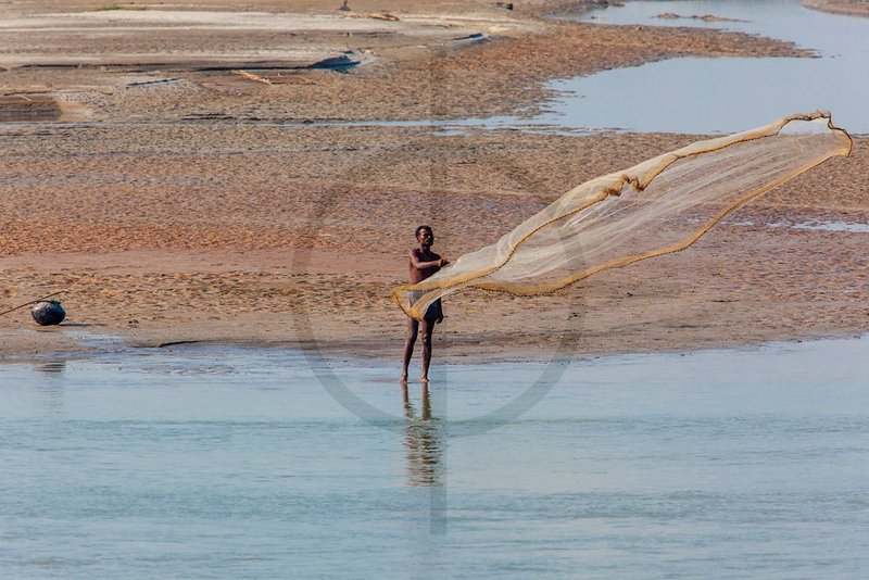 Fisherman, banks of the Sapta Koshi River, Nepal