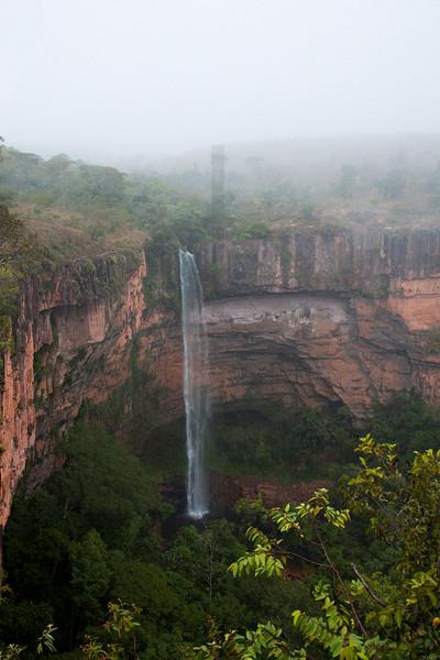Bridal Veil Waterfall in morning mist, Chapada dos Guimerães National Park, Mato Grosso, Brazil