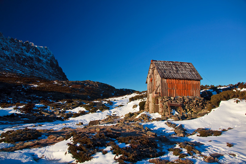Kitchen Hut and Cradle Mountain on a wintry morning, Overland Track, Tasmania, Australia