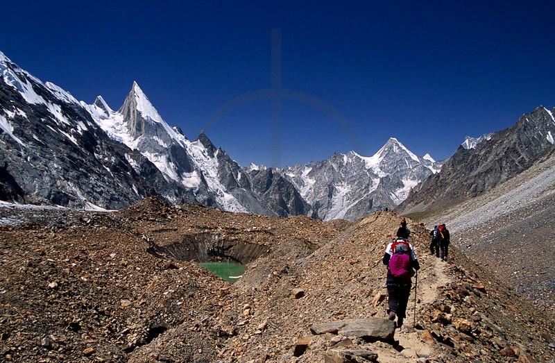 Walking over the moraine of Gondogoro Glacier towards Laila Peak, Hushe Valley, Baltistan, Pakistan
