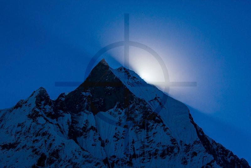 The sun behind Machapurare Mountain as seen from Annapurna Sanctuary, Nepal