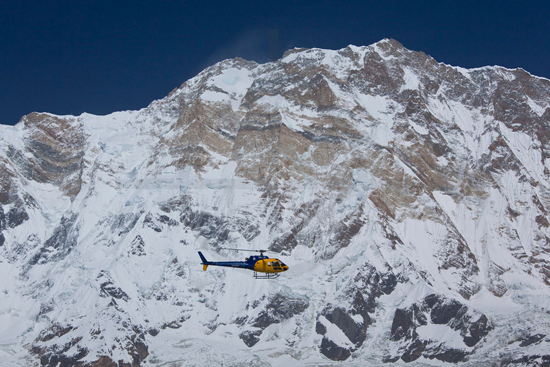 Rescue helicopter with Annapurna I as a backdrop, Annapurna Sancuary, Nepal
