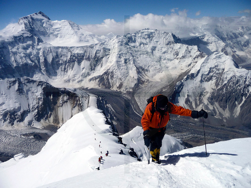 Mountaineer on the summit ridge of Pik Korzhevenskaya, Pamir, Tajikistan