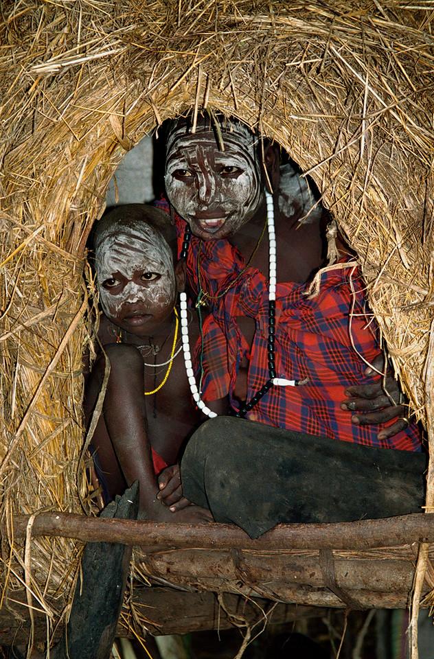 Mursi children in their hut, Mago National Park, Lower Omo Valley, Southern Ethiopia