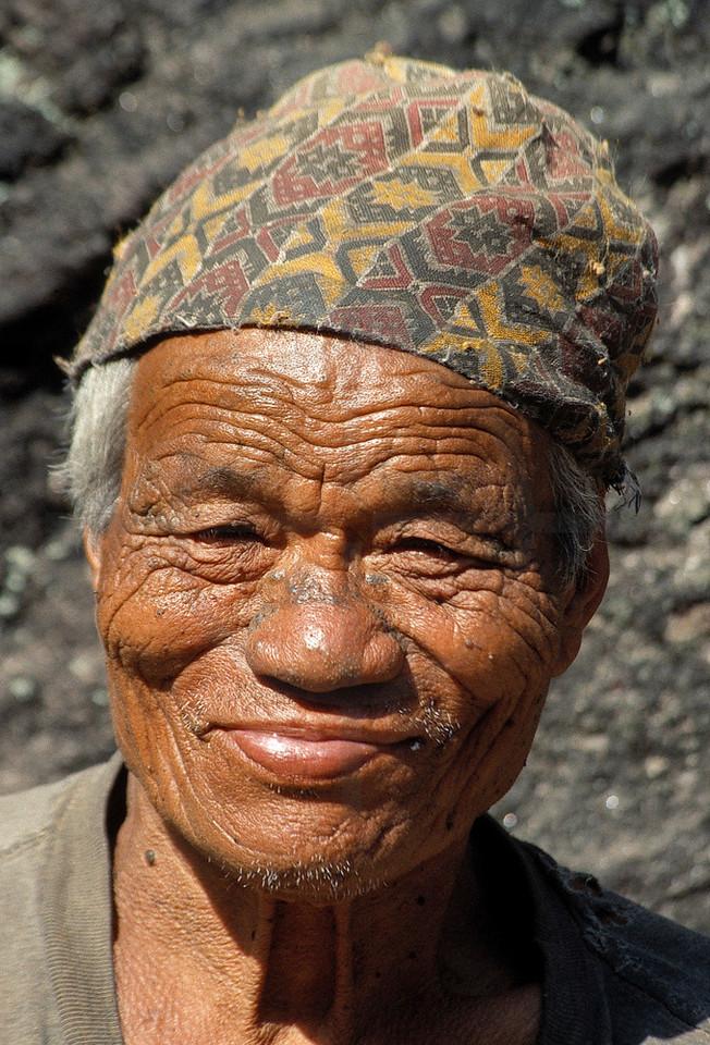 Nepali farmer sporting a dhaka topi, Annapurna region, Nepal