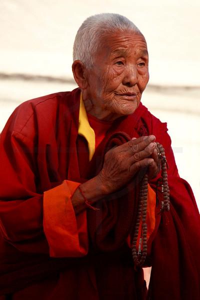 Devout Buddhist nun, Boudhanath, Kathmandu Valley, Nepal