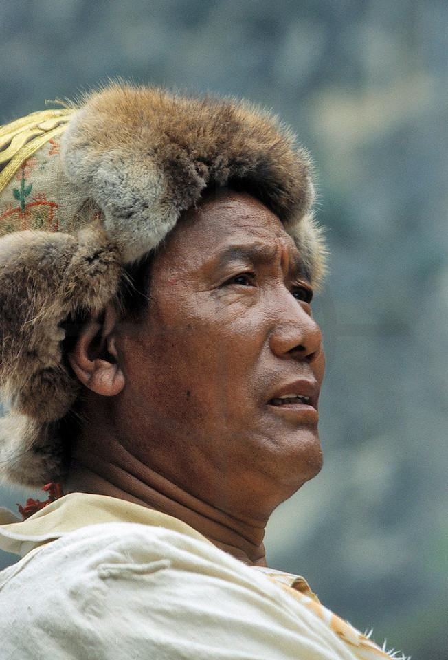 Man sporting a Tibetan fur hat, Bagarchhap, Annapurna Circuit, Nepal