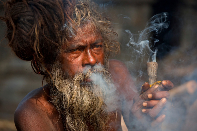 Sadhu smoking a joint on Shiva Day, Pashupatinath, Kathmandu Valley, Nepal