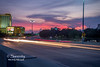 Sunset  over Highway 90 in Biloxi, created on the pedestrian bridge that runs beside the roadway!