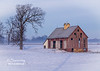 Fog is seen in the distant field behind this interesting old barn surrounded by a winter scene!