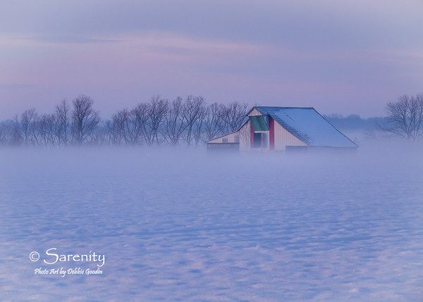 Amazing fog lifts from the snow covered ground surrounding this old barn!