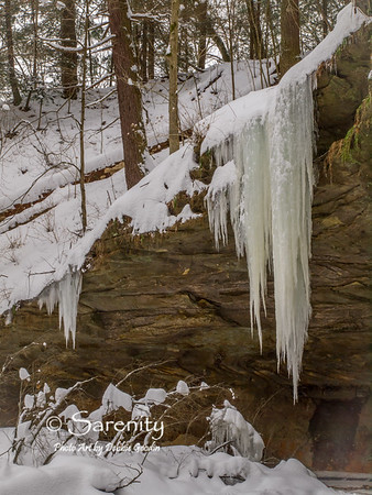 Beautiful icicles hanging from the walls of  this rock face!