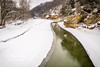 A winter scene captured from the suspension Bridge!  The frozen waters of Sugar Creek are broken only by one pathway of moving water!