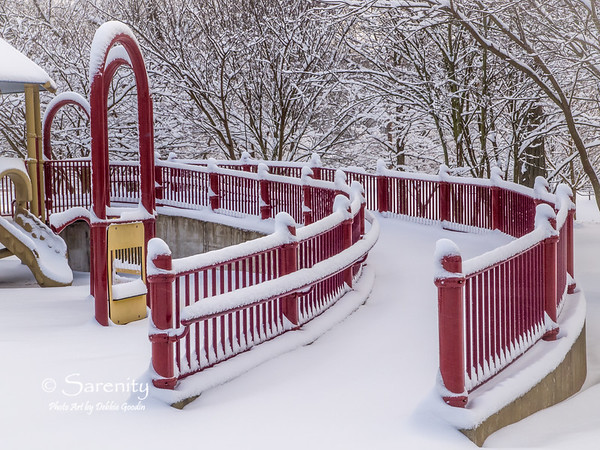 I love how the red of this railing on the playground ramp stands out from the surrounding white blanket of snow!