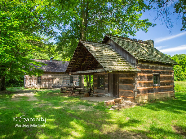 A log cabin located inside the Pioneer Village at Fowler Park in Vigo County, IN!  In the background is the blacksmith shop!