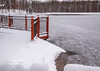 The blowing wind created interesting lines on the frozen waters of Maple Avenue Lake!  The lines of the snow and red fence help pull you into this Winter scene!