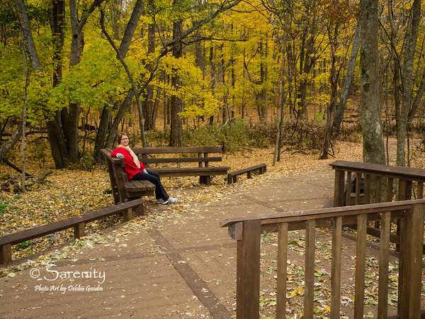 A park visitor enjoys the beautiful Fall colors at Radnor Lake State Park