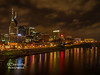 The beautiful Downtown Nashville Skyline lite up at night!  The amazing colors of the nights lights are reflected in the waters of the Cumberland River!