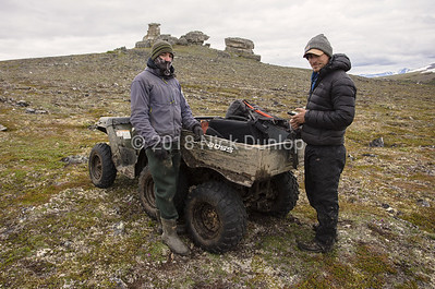 Devin and Mike at a gyrfalcon cliff. Six wheeler offroad ATV's are used extensively by the falcon crew. To minimize damage to the tundra, they followed established trails whenever possible.