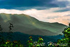 The dark clouds, green foliage, and sun peaking through made the Blue Ridge mountains an emerald green in color.